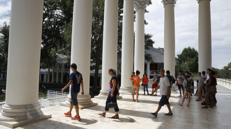 First year students tour the Rotunda of the University of Virginia, Friday, Aug. 18, 2017, in Charlottesville, Va., a week after a white nationalist rally took place on campus. (AP Photo/Jacquelyn Martin)