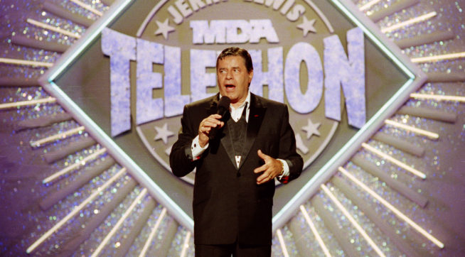 FILE - In this Sept. 2, 1990 file photo, entertainer Jerry Lewis makes his opening remarks at the 25th Anniversary of the Jerry Lewis MDA Labor Day Telethon fundraiser in Los Angeles. MDA said Friday, May 1, 2015, that the Labor Day television fundraising tradition for decades, is ending. Celebrities including Frank Sinatra, John Lennon and Michael Jackson to Pitbull and Jennifer Lopez have performed on the telethon, first hosted by Lewis and Dean Martin in 1956. It moved to Labor Day in 1966. (AP Photo/Julie Markes, File)