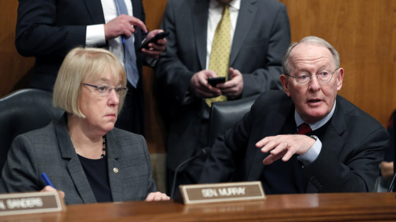 Senate Health, Education, Labor, and Pensions Committee Chairman Sen. Lamar Alexander, R-Tenn., accompanied by the committee's ranking member Sen. Patty Murray, D-Wash. speaks on Capitol Hill in Washington, Tuesday, Jan. 31, 2107, during the committee's executive session to discuss the nomination of Education Secretary-designate Betsy DeVos.  (AP Photo/Alex Brandon)