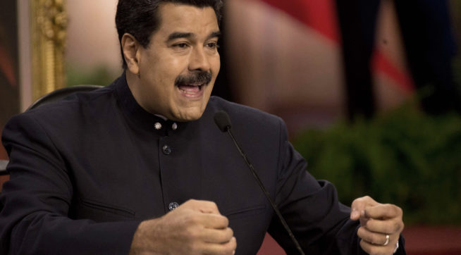 Venezuela's President Nicolas Maduro speaks at a news conference with International press in Caracas, Venezuela, Tuesday, Aug. 22, 2017. Maduro spoke about the next regional elections in the country and the bad relations with the Government of the United State. (AP Photo/Ariana Cubillos)