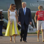 President Donald Trump, first lady Melania Trump and son Barron Trump walk across the tarmac before boarding Air Force One at Morristown Municipal Airport, Sunday, Aug. 20, 2017, in Morristown, N.J., for the return flight to the Washington area. (AP Photo/Pablo Martinez Monsivais)