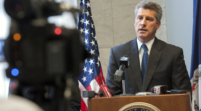U.S Attorney Tim Heaphy talks about human trafficking in the area after the sentencing of Elin Coello-Ordonez, who smuggled an 18-year-old Honduras woman into the country and forced her to work as a prostitute in brothels in Harrisonburg, Charlottesville, Maryland and Pennsylvania, Wednesday, Oct. 15, 2014 in Harrisonburg, Va. (AP Photo/Daily News-Record, Nikki Fox)