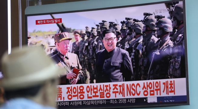 """A man watches a TV screen showing a local news program reporting on North Korea's missiles with an image of North Korea's leader Kim Jong Un at the Seoul Train Station in Seoul, South Korea, Saturday, Aug. 26, 2017. Three North Korea short-range ballistic missiles failed on Saturday, U.S. military officials said, which, if true, would be a temporary setback to Pyongyang's rapid nuclear and missile expansion. The banners read """"South Korean Presidential Office, National Security Director Chung Eui-yong chaired a National Security Council meeting."""" (AP Photo/Lee Jin-man)"""