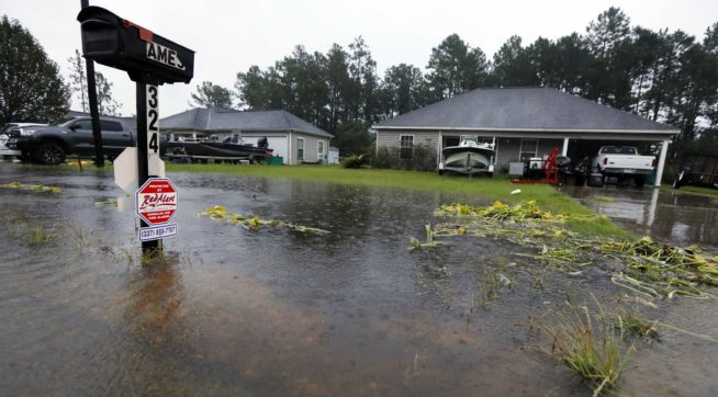 Rising waters threaten these homes along North Perkins Ferry Road in Moss Bluff, La., near Lake Charles, La., as a constant rain from Tropical Storm Harvey falls, Monday, Aug. 28, 2017. (AP Photo/Rogelio V. Solis)