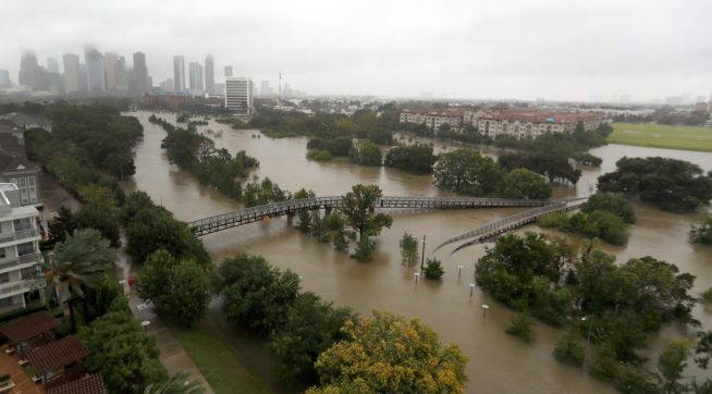 An overhead view of the flooding in Houston, from Buffalo Bayou on Memorial Drive and Allen Parkway, as heavy rains continue falling from Tropical Storm Harvey, Monday, Aug. 28, 2017. Houston was still largely paralyzed Monday, and there was no relief in sight from the storm that spun into Texas as a Category 4 hurricane, then parked itself over the Gulf Coast. (Karen Warren/Houston Chronicle via AP)