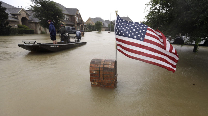 Volunteers use their boat to help evacuate residents as floodwaters from Tropical Storm Harvey rise Monday, Aug. 28, 2017, in Spring, Texas. (AP Photo/David J. Phillip)