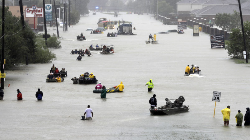 Rescue boats fill a flooded street at flood victims are evacuated as floodwaters from Tropical Storm Harvey rise Monday, Aug. 28, 2017, in Houston. (AP Photo/David J. Phillip)