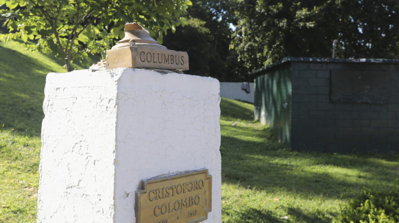 In this Aug. 30, 2017 photo, the base of the bust of Christopher Columbus remains on top of its pedestal at Columbus Park in Yonkers, N.Y., after the statue was attacked by vandals. Although it is unclear whether the vandalism is related to the recent controversy, activists in New York and elsewhere have targeted Columbus statues. (Mark Vergari/The Journal News via AP)
