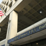 The FBI's J. Edgar Hoover Headquarters, acros the street from the Deparment of Justice, in Washington, Wednesday, Nov. 2, 2016. (AP Photo/Cliff Owen)
