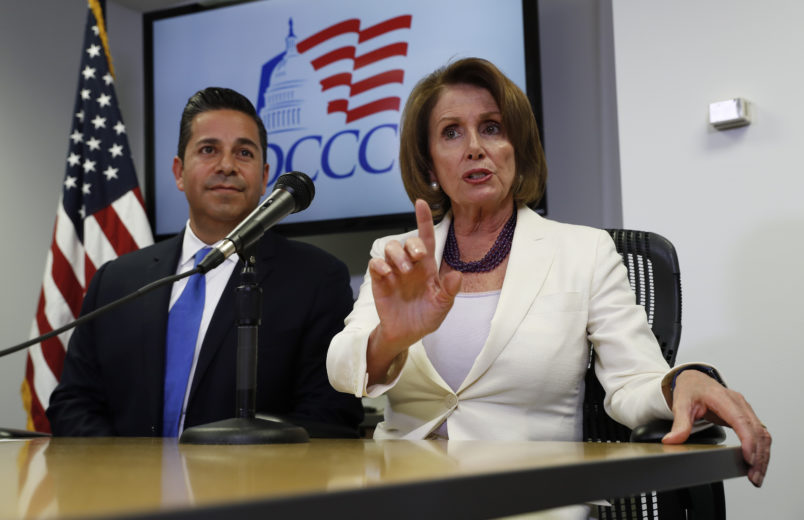 House Minority Leader Nancy Pelosi (D-CA) and Democratic Congressional Campaign Committee Chairman Ben Ray Lujan, (D-NM) speak on election day 2016. (AP Photo/Carolyn Kaster)