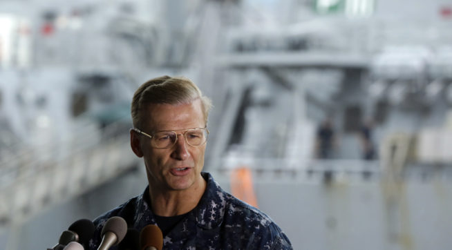 Vice Adm. Joseph Aucoin, Commander, U.S. 7th Fleet, speaks during a press conference with damaged USS Fitzgerald as background at the U.S. Naval base in Yokosuka, southwest of Tokyo Sunday, June 18, 2017. (AP Photo/Eugene Hoshiko)