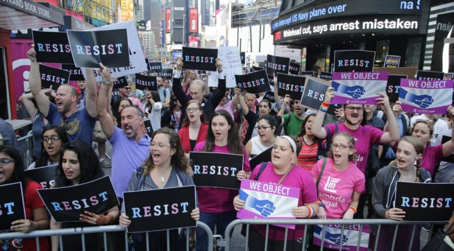 Protestors gather in Times Square Wednesday, July 26, 2017, in New York. (AP Photo/Frank Franklin II)