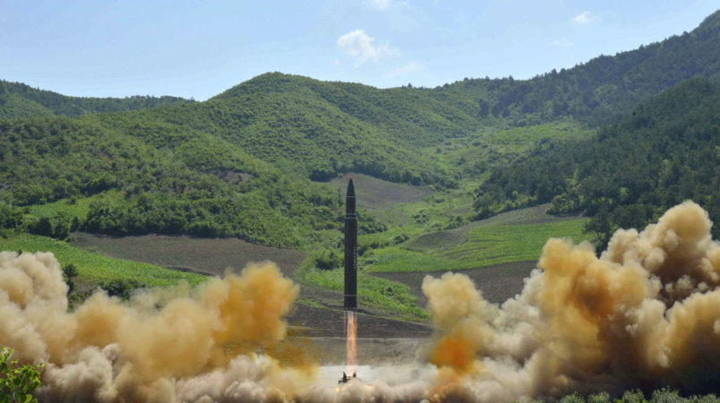 FILE- In this July 4, 2017, file photo distributed by the North Korean government shows what was said to be the launch of a Hwasong-14 intercontinental ballistic missile, ICBM, in North Korea's northwest. North Korea has been condemned and sanctioned for its nuclear ambitions, yet has still received food, fuel and other aid from its neighbors and adversaries for decades. How does the small, isolated country keep getting what it wants and needs to prevent its collapse?(Korean Central News Agency/Korea News Service via AP, File)