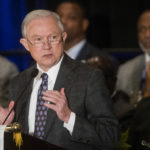 "Attorney General Jeff Sessions addresses the National Organization of Black Law Enforcement Executives during a    conference, Tuesday, August 1, 2017, in Atlanta. President Trump recently used a speech before law enforcement to encourage them to be ""rough"" on suspects. (John Amis/Special)"