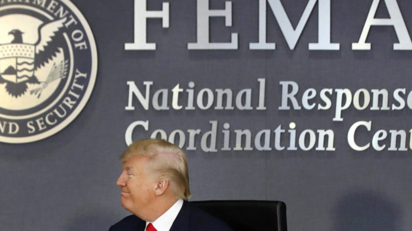 President Donald Trump turns to Vice President Mike Pence as they meet with emergency officials to discuss the hurricane season, Friday, Aug. 4, 2017, at Federal Emergency Management Agency (FEMA) headquarters in Washington. (AP Photo/Jacquelyn Martin)