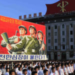 Tens of thousands of North Koreans gathered for a rally at Kim Il Sung Square carrying placards and propaganda slogans as a show of support for their rejection of the United Nations' latest round of sanctions on Wednesday Aug. 9, 2017, in Pyongyang, North Korea. (AP Photo/Jon Chol Jin)
