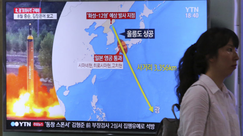 "A woman passes by a TV screen showing a local news program reporting on North Korea threatens to strike Guam with ballistic missiles at the Seoul Train Station in Seoul, South Korea, Thursday, Aug. 10, 2017.  North Korea has announced a detailed plan to launch a salvo of ballistic missiles toward the U.S. Pacific territory of Guam, a major military hub and home to U.S. bombers. If carried out, it would be the North's most provocative missile launch to date. The signs at left top read "" North Korea announced a plan to launch a salvo of ballistic missiles toward the Guam. (AP Photo/Ahn Young-Joon)"