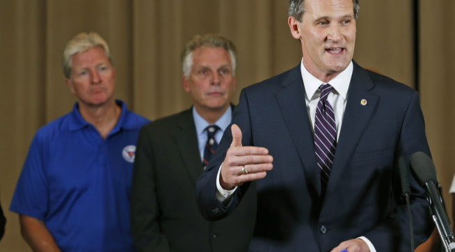 Charlottesville mayor, Mike Signer, right, gestures during a news conference as Virginia Gov. Terry McAuliffe, center, and Virginia Secretary of Public safety, Brian Moran,left, as  they address the the Alt Right rally and violence in Charlottesville, Va., Saturday, Aug. 12, 2017.  (AP Photo/Steve Helber)