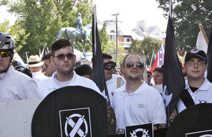 In this Saturday, Aug. 12, 2017 photo released by Alan Goffinski, James Alex Fields Jr., second from left, stands with a handful of men, all dressed similarly in the Vanguard America uniform of khakis and white polo shirts, in Charlottesville, Va. Fields, is accused of crashing into a crowd protesting a white supremacist rally in Virginia. (AP Photo/Alan Goffinski)