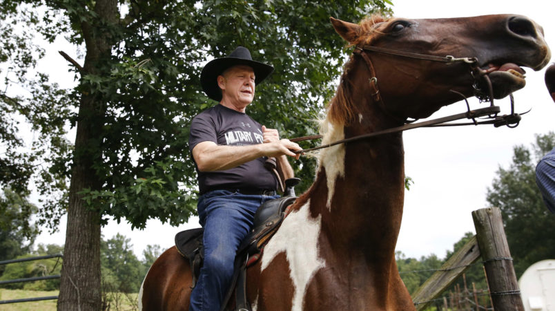 """Former Alabama Chief Justice and U.S. Senate candidate Roy Moore, rides in on a horse named """"Sassy"""" to vote a the Gallant Volunteer Fire Department, during the Alabama Senate race, Tuesday, Aug. 15, 2017, in Gallant, Ala. (AP Photo/Brynn Anderson)"""