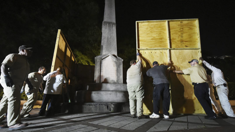 Birmingham city workers covered the Confederate Monument in Linn Park Tuesday night on orders from Mayor William Bell. It took the workers about 45 minutes to erect the 12x16 foot plywood enclosure around the base of the monument. (Joe Songer | jsonger@al.com).