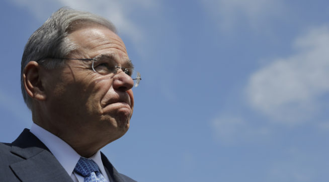 U.S. Sen. Bob Menendez fields questions about his upcoming trial in which he is facing federal corruption charges after completing a flood insurance news conference, Thursday, Aug. 17, 2017, in Union Beach, N.J. (AP Photo/Julio Cortez)