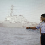 """Malaysian Maritime Director Indera Abu Bakar show the damage of USS John S. McCain ship during a press conference in Putrajaya, Malaysia on Monday, Aug. 21, 2017. The U.S. Navy says the USS John S. McCain has arrived at Singapore's naval base with """"significant damage"""" to its hull after a collision early Monday between it and an oil tanker. (AP Photo/Daniel Chan)"""