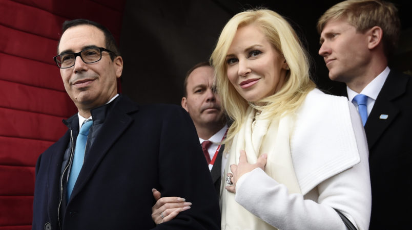 Treasury Secretary-designate Stephen Mnuchin and his fiancee Louise Linton arrive on Capitol Hill in Washington, Friday, Jan. 20, 2017, for the presidential inauguration of Donald Trump. (Saul Loeb/Pool Photo via AP)