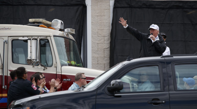 President Donald Trump talks with supporters outside Firehouse 5 where he received a briefing on Hurricane Harvey relief efforts, Tuesday, Aug. 29, 2017, in Corpus Christi, Texas. (AP Photo/Evan Vucci)