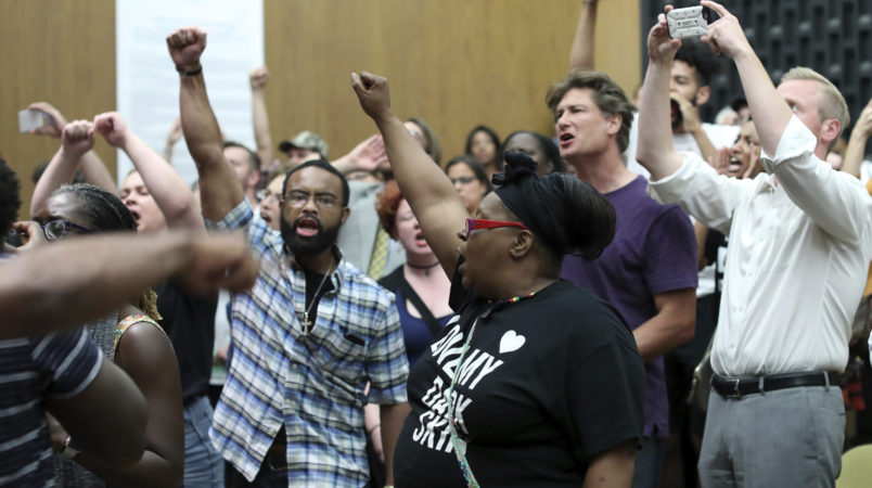 Emotions run high during the Charlottesville City Council meeting Monday night in Charlottesville, Va. Photo/Andrew Shurtleff/The Daily Progress