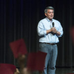 "Republican Sen. Cory Gardner of Colorado speaks at a town hall as guests hold red ""disagree"" and green ""agree"" cards Tuesday, Aug. 15, 2017, at Pikes Peak Community College in Colorado Springs, Colo."