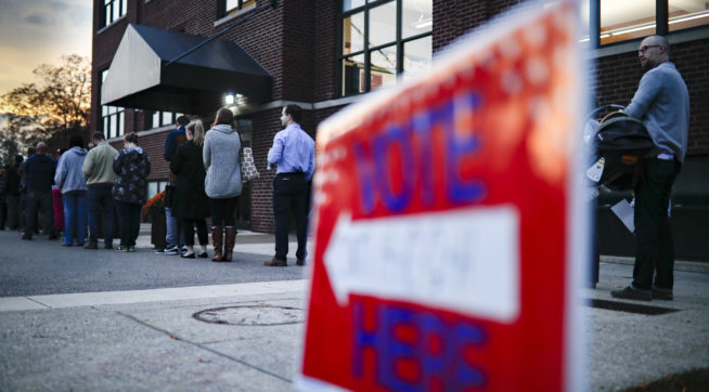 Voter wait in line outside a polling place at the Nativity School on Election Day, Tuesday, Nov. 8, 2016, in Cincinnati. (AP Photo/John Minchillo)