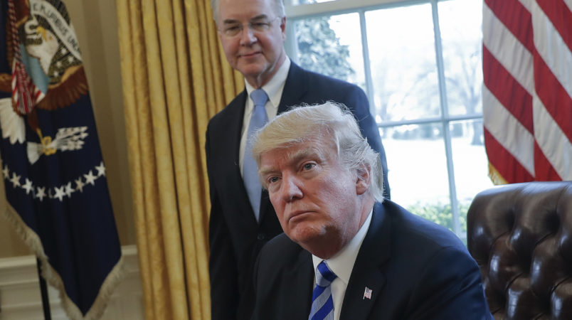 President Donald Trump with Health and Human Services Secretary Tom Price, listens after addressing members of the media regarding the health care overhaul bill, Friday, March 24, 2017, in the Oval Office of the White House in Washington. (AP Photo/Pablo Martinez Monsivais)