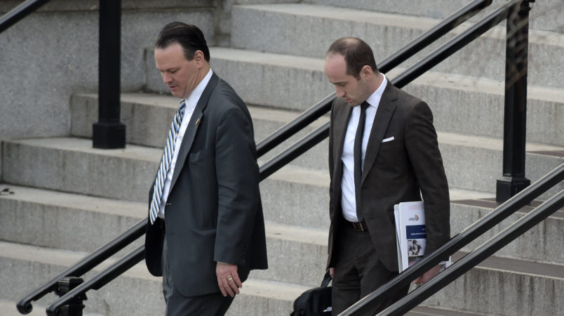 Trump deputy chief of staff for policy, Rick Dearborn, left, and senior policy adviser Stephen Miller, right, walk down the steps of the Eisenhower Executive Office Building on the White House complex in Washington, Friday, Jan. 13, 2017, following a meeting. (AP Photo/Susan Walsh)