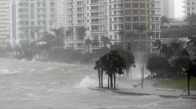 Waves crash over a seawall at the mouth of the Miami River from Biscayne Bay as Hurricane Irma passes by, Sunday, Sept. 10, 2017, in Miami. (AP Photo/Wilfredo Lee)