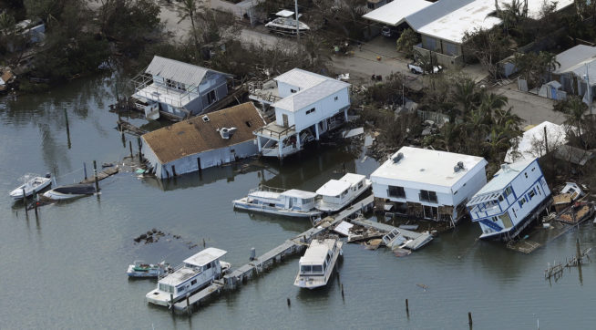 Homes are shown damaged from storm surge  from Hurricane Irma Tuesday, Sept. 12, 2017, in Key West, Fla.  (AP Photo/Chris O'Meara)