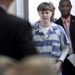 FILE - In this Monday, April 10, 2017, file photo, Dylann Roof enters the court room at the Charleston County Judicial Center to enter his guilty plea on murder charges in Charleston, S.C. Federal officials are for the first time showing videos of convicted the South Carolina church shooter's jailhouse visits with his family on Tuesday, May 16. (Grace Beahm/The Post And Courier via AP, Pool, File)