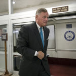 Sen. Richard Burr, R-N.C., chairman of the Senate Select Committee on Intelligence, rushes through a subway corridor at the Capitol in Washington, Tuesday, Sept. 19, 2017.   (AP Photo/J. Scott Applewhite)