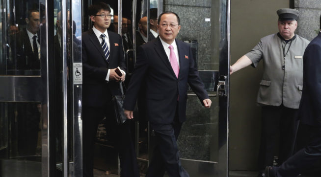 North Korea's Foreign Minister Ri Yong Ho, center, followed by his interpreter, left, walks to the microphones to speak outside the U.N. Plaza Hotel, in New York, Monday, Sept. 25, 2017. (AP Photo/Richard Drew)