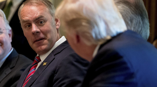 Interior Secretary Ryan Zinke, center, and Health and Human Services Secretary Tom Price, left, listen as President Donald Trump speaks during a Cabinet meeting, Monday, June 12, 2017, in the Cabinet Room of the White House in Washington. (AP Photo/Andrew Harnik)
