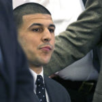 FILE - In this April 15, 2015, file photo, former New England Patriots football player Aaron Hernandez listens as the verdict is read finding him guilty in the shooting death of Odin Lloyd, at the Bristol County Superior Court in Fall River, Mass. In court documents filed Monday, May 1, 2017, prosecutors asked a judge to reject a request by attorneys for Hernandez to dismiss his murder conviction because he died before having his appeal heard. Hernandez was found hanged in his prison cell on April 19, 2017.  (Dominick Reuter/Pool Photo via AP, File)