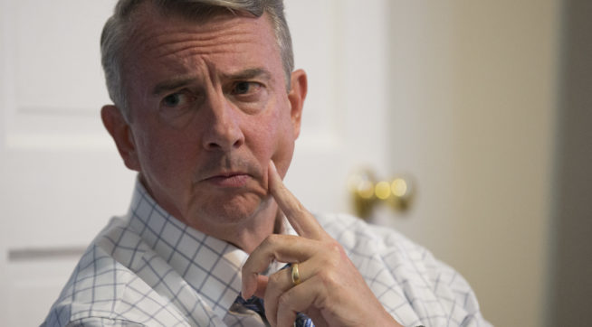 Republican Gubernatorial candidate Ed Gillespie talks with a group of recovering addicts at the Recovery House in Richmond, Va., Wednesday, Aug. 30, 2017.  Gillespie a polished Washington insider, has long advocated that eh GOP needs to be more welcoming of minorities and immigrants.  (AP Photo/Steve Helber)