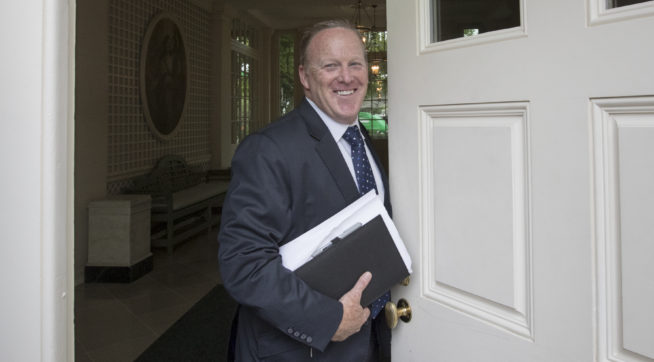 Sean Spicer, President Donald Trump's oft-beleaguered press secretary, stands in the doorway to the Palm Room at the White House in Washington during renovations to the West Wing, Friday, Aug. 11, 2017.   (AP Photo/J. Scott Applewhite)