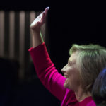 "Hillary Clinton waves to the audience as she at the Warner Theatre in Washington, Monday, Sept. 18, 2017, for book tour event for her new book ""What Happened"" hosted by the Politics and Prose Bookstore. (AP Photo/Carolyn Kaster)"