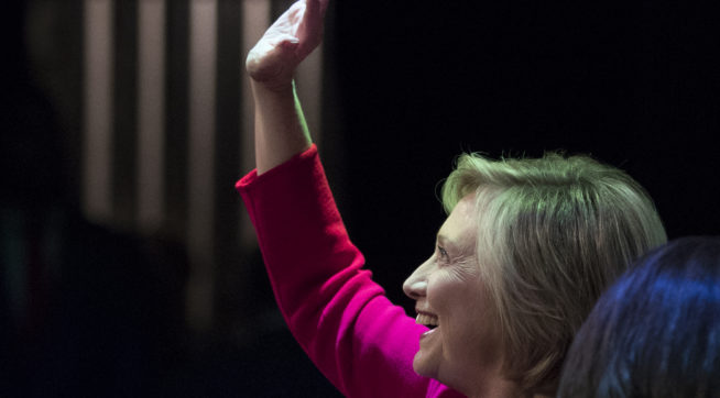 """Hillary Clinton waves to the audience as she at the Warner Theatre in Washington, Monday, Sept. 18, 2017, for book tour event for her new book """"What Happened"""" hosted by the Politics and Prose Bookstore. (AP Photo/Carolyn Kaster)"""
