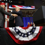 President Donald Trump hugs U.S. Senate candidate Luther Strange during a campaign rally, Friday, Sept. 22, 2017, in Huntsville, Ala. (AP Photo/Evan Vucci)