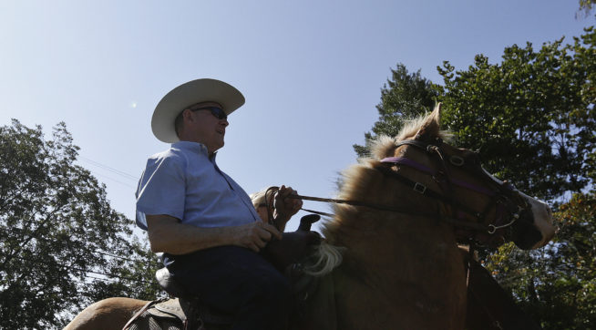 Former Alabama Chief Justice and U.S. Senate candidate Roy Moore, rides in on a horse to vote a the Gallant Volunteer Fire Department, during the Alabama Senate race, Tuesday, Sept. 26, 2017, in Gallant, Ala. (AP Photo/Brynn Anderson)