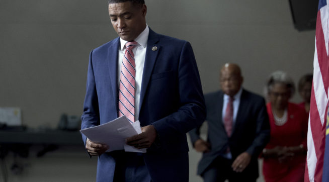 From left, Congressional Black Caucus Chairman Rep. Cedric Richmond, D-La., Rep. John Lewis, D-Ala., and Rep. Joyce Beatty, D-Ohio, arrive for a Congressional Tri-Caucus news conference on Capitol Hill in Washington, Wednesday, Sept. 27, 2017, on injustice and inequality in America. The Congressional Tri-Caucus is comprised of the Congressional Black Caucus, Congressional Hispanic Caucus and the Congressional Asian Pacific American Caucus. (AP Photo/Andrew Harnik)