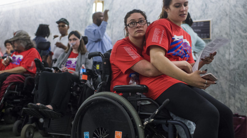 UNITED STATES - SEPTEMBER 25: Shaylin Sluzalis, right, and her sister Brittani, who has cerebral palsy, wait in line for a Senate Finance Committee hearing in Dirksen on the proposal by Sens. Lindsey Graham,R-S.C., and Bill Cassidy, R-La., to repeal and replace the Affordable Care Act, which they oppose, on September 25, 2017. Both senators are scheduled to testify. (Photo By Tom Williams/CQ Roll Call)