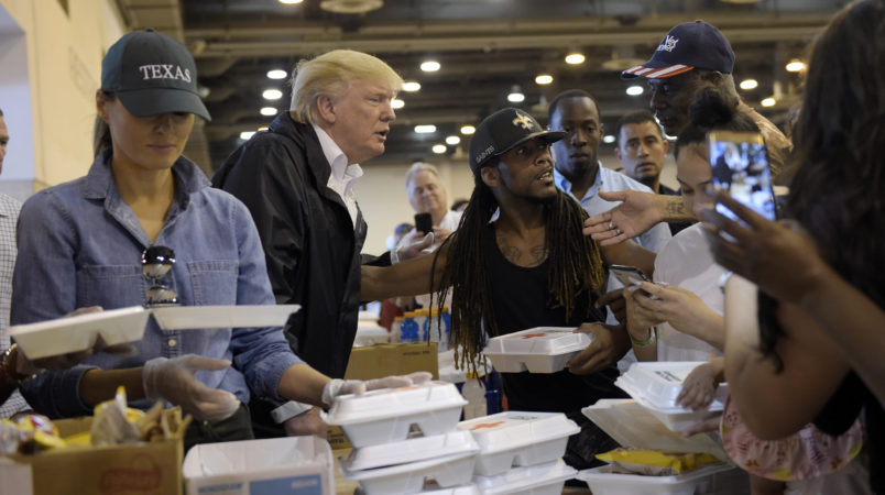 President Donald Trump and Melania Trump pass out food and meet people impacted by Hurricane Harvey during a visit to the NRG Center in Houston, Saturday, Sept. 2, 2017. The Trumps will also make a stop in Lake Charles, La., to meet with people at an emergency operations center. (AP Photo/Susan Walsh)